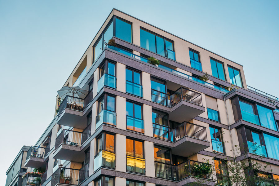 Condo Building Insurance - Condo Building with Balconies and Blue Skies