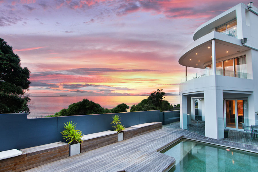 High Net Worth Insurance - Modern Home with Swimming Pool and Deck